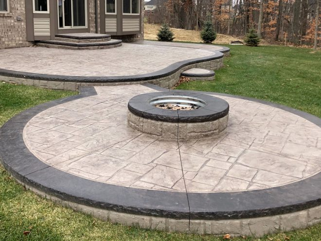 stamped concrete patio with firepit contractor